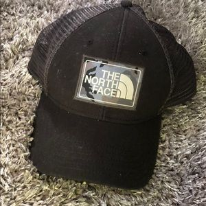 The North Face black and gray snap back hat